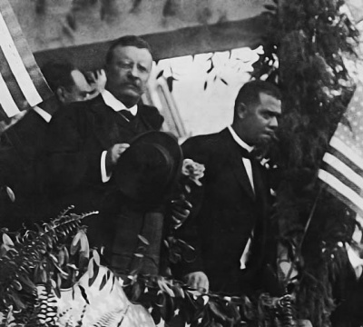 Which president was the first to invite an African-American to dine at the White House?
